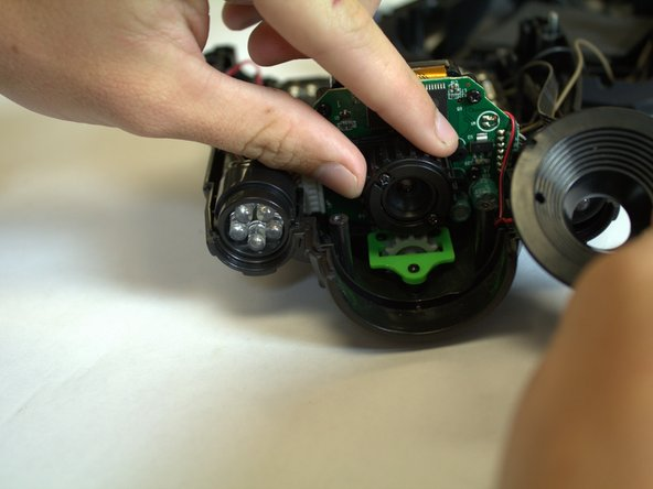 Once the device is open, remove the lens tunnel, then twist the lens to unscrew it from the camera.