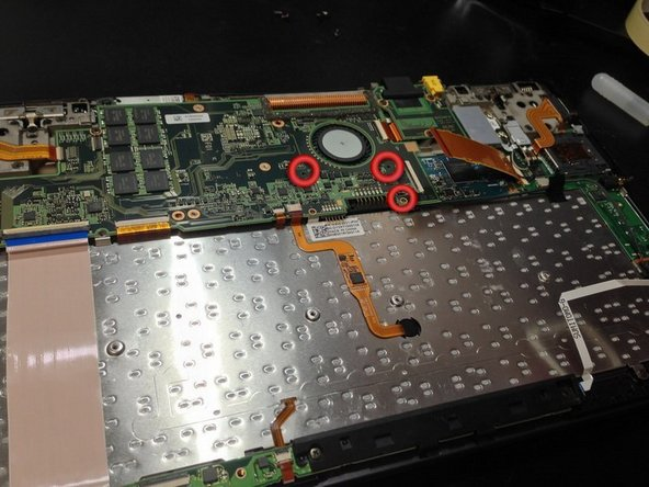 Remove these screws to make it easier to remove the SSD.