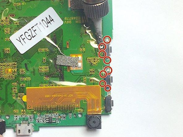 De-solder volume buttons' eight contact points.