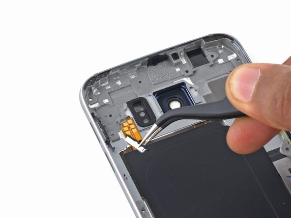 Use tweezers to remove the button covers.