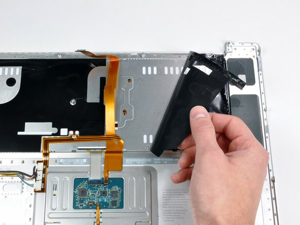 In this step you will be peeling adhesive to give access to screws, it is not necessary to fully remove these shields.