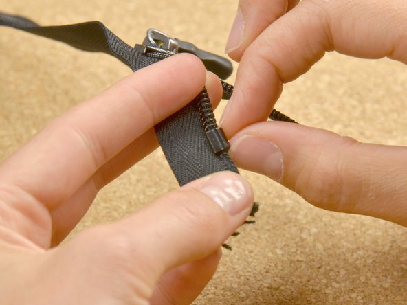 Place the zipper stop directly above the last tooth on the zipper. Be sure you get all the way around the zipper.