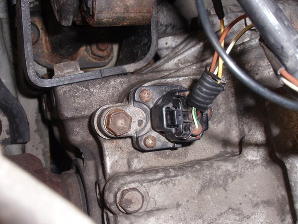 Disconnect sensor now, or disconnect it later.  You might find it easier to unplug sensor after removing it from transaxle, when it is less far away from you, then easier to reach.