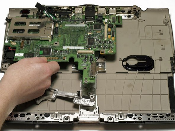 Gently lift the front edge of the logic board and then pull it toward you.