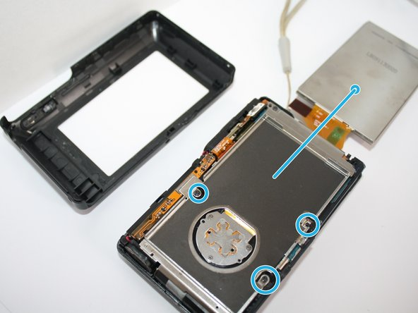Now that you have the back casing off, gently remove the LCD screen from the camera.