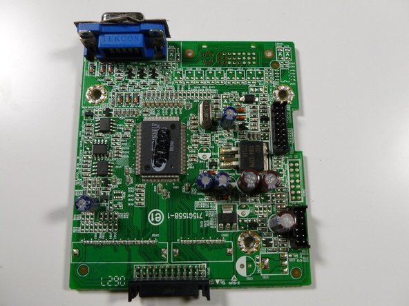 Set the circuit board down on its own, removed from the rest of the monitor.