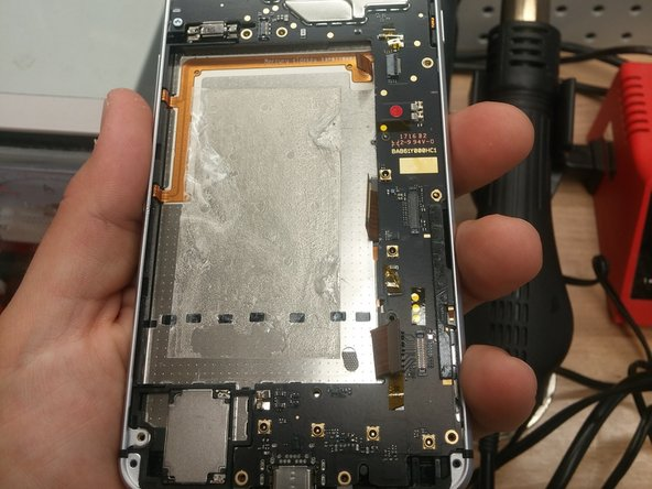 With the battery out disconnect the three flex cables and remove the remaining two Phillips screws from this area of the motherboard.