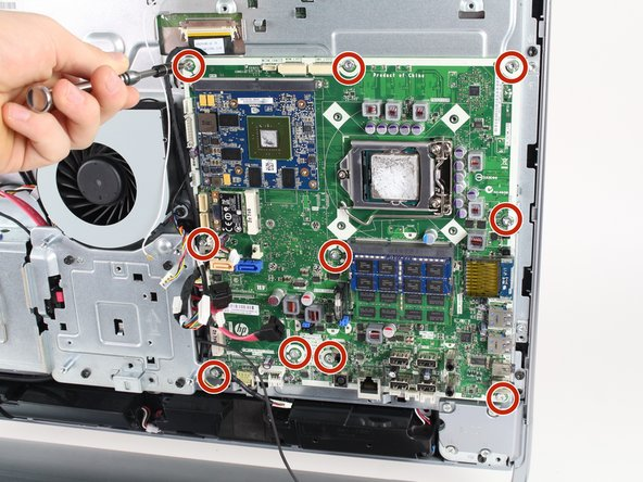 Remove the ten 7mm T15 screws from the motherboard.