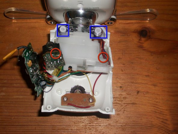 remove 2 screws holding motor to battery compartment that were hidden beneath jack and wiring near battery opening.