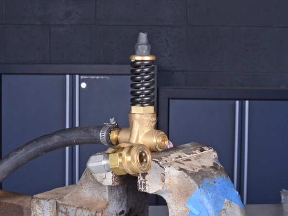 You will need to remove the remaining fittings from the output assembly in order to replace the unloader.