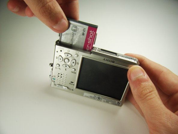 Carefully remove the exposed battery.