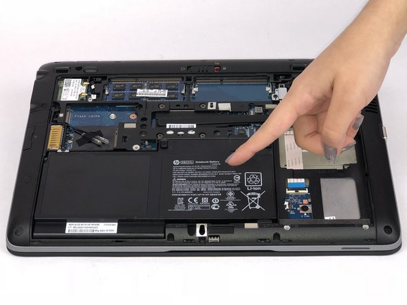 Remove the back cover and you will then be able to see the battery.