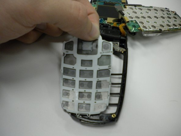 Lift the number pad straight up from the casing.