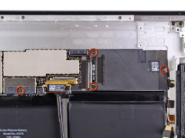 Remove the four 2.6 mm Phillips screws securing the logic and communications boards to the rear panel.