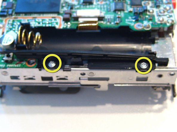 Remove 2 screws under the battery case. There are 6 more screws on the logic board that need to be removed, 3 on the right-hand side and 2 on the left with the final one hidden under the battery case.