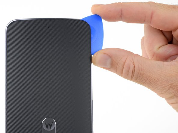 Slice through the adhesive along the left side of the phone.