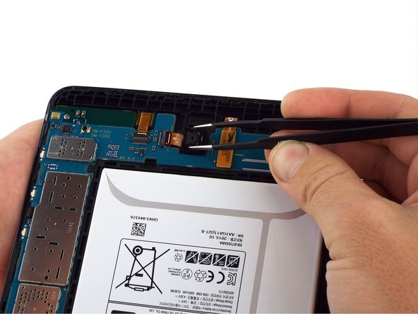 Use the tweezers to fully remove the camera from the rest of the device. The camera should be pulled out and away from where the device was connected to the motherboard in Step 3.