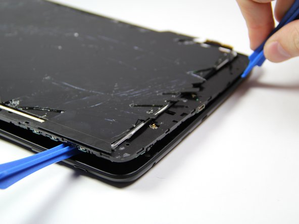 Insert another plastic opening tool (or a similar tool) between the screen and the back panel on the opposite side of the device to hold it open.