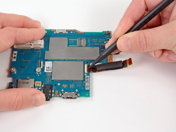 Release the tab on the large ZIF connector on the right side of the motherboard by lifting the tab with a spudger.