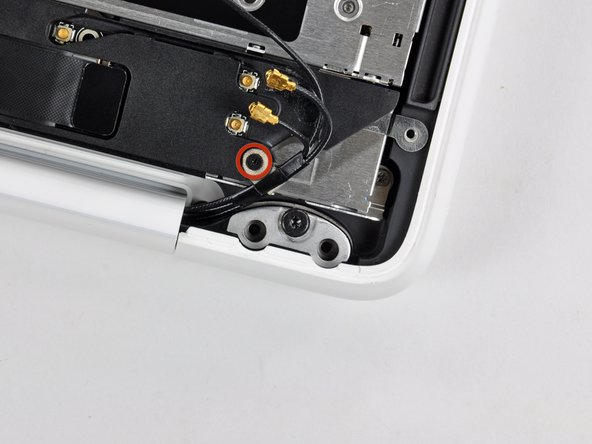 Remove the single 3 mm Phillips screw securing the antenna ground straps to the rear speaker housing.