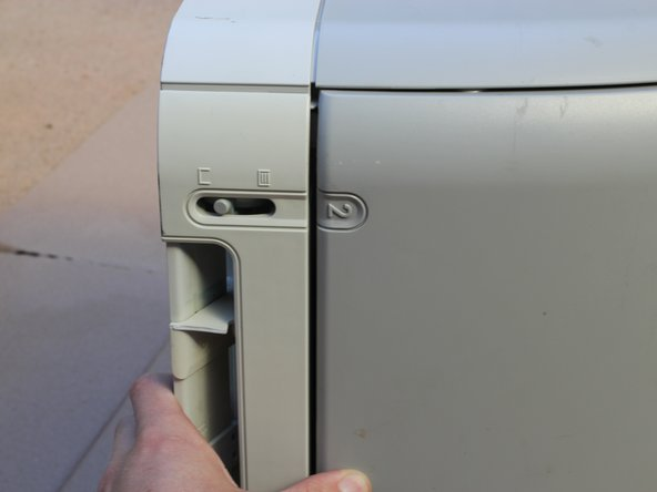 Place the printer so that the right side is on the ground.