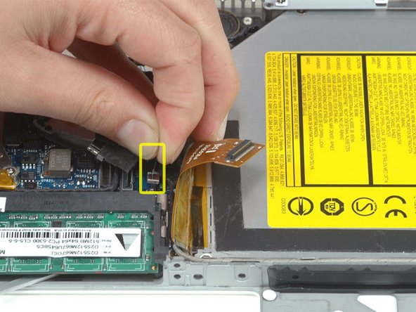 Disconnect the (once again) newly-revealed hard drive cable.