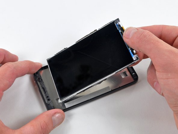 Lift the LCD panel assembly out of the inner case.