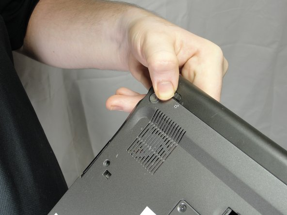 Slide and hold the switch by the fan vent to the unlocked position. Firmly grasp the battery and pull away from tablet.