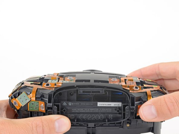 Lift the sensor array away from the headset to remove it.