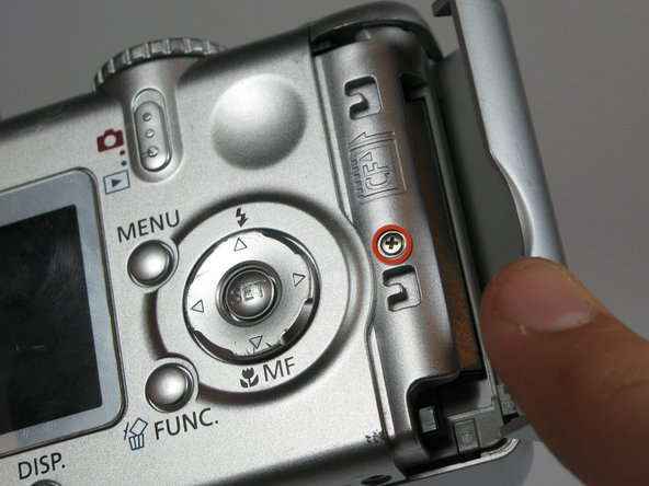 Remove the 2.4mm screw located underneath the cover of the memory card slot.