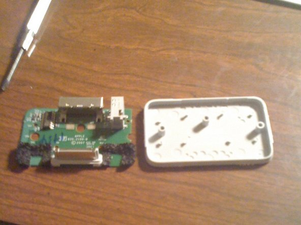 Once done separating the logic board from the bottom plate, you should have 2 parts.