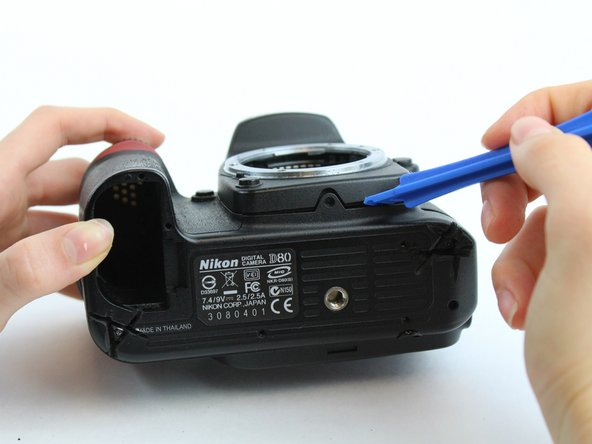 Use the plastic opening tool to remove the bottom cover.