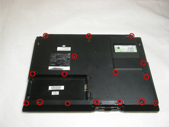 Remove screws from bottom of laptop as shown in the picture.