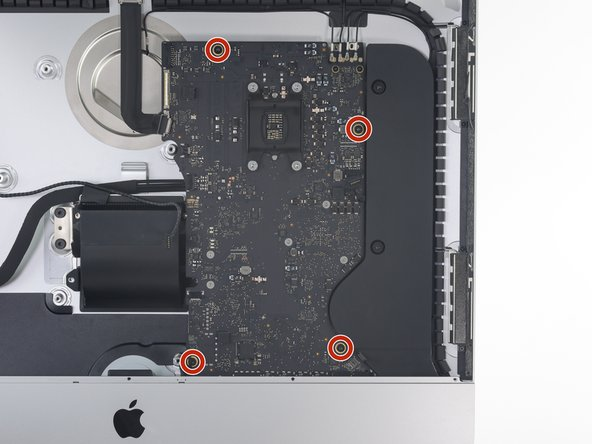 Remove the four 7.3 mm T8 Torx screws securing the logic board to the rear enclosure.