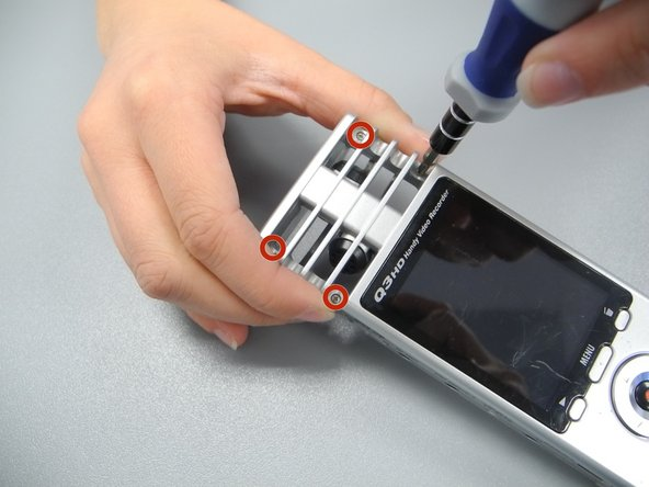 Flip the device over and remove the four screws bordering the grate of the device.