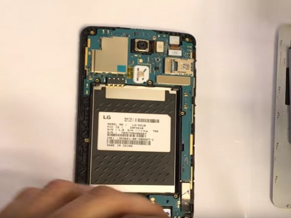 Use finger nail or wedge to gently remove dust cover, and reveal the motherboard.