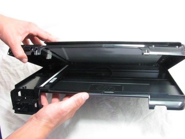 Pull the printer hood upward.