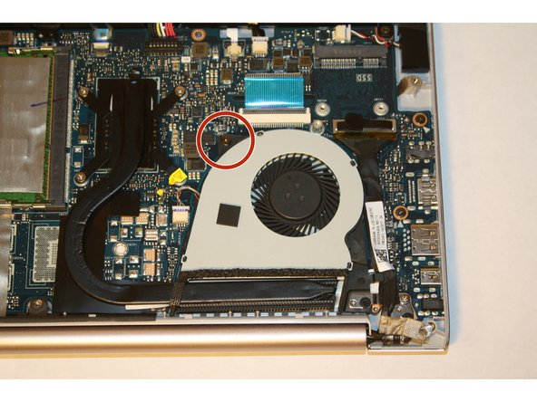Remove the screw attaching the cooling fan to the motherboard.