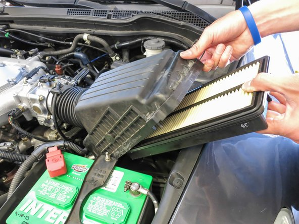 Remove the old air filter by gently pulling it from the top of the Air Filter housing.