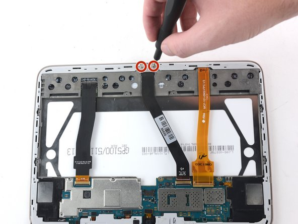 Use a Phillips #000 screwdriver to remove the two 3mm screws in the metal plate connecting the charging port to the display assembly.