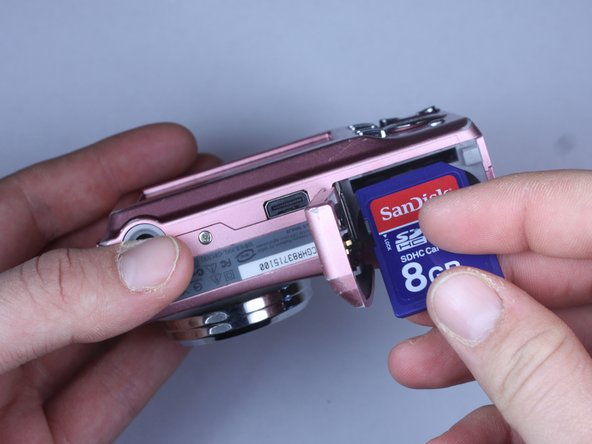 Locate memory card slot and insert memory card by inserting the gold terminals first.