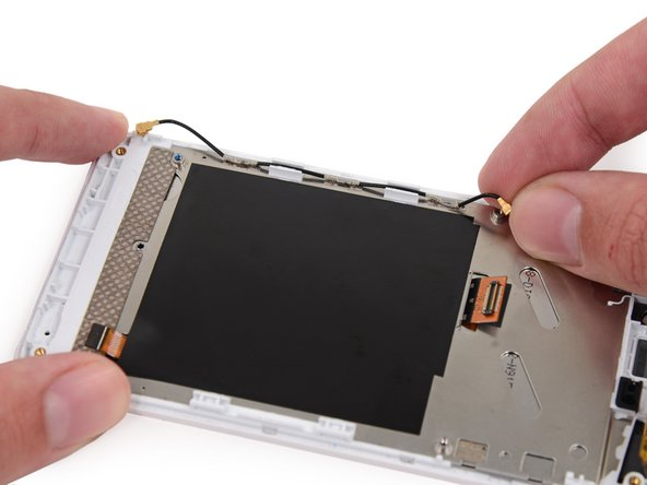 Remove the antenna interconnect cable from the display assembly.