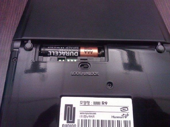 Insert batteries into slot.