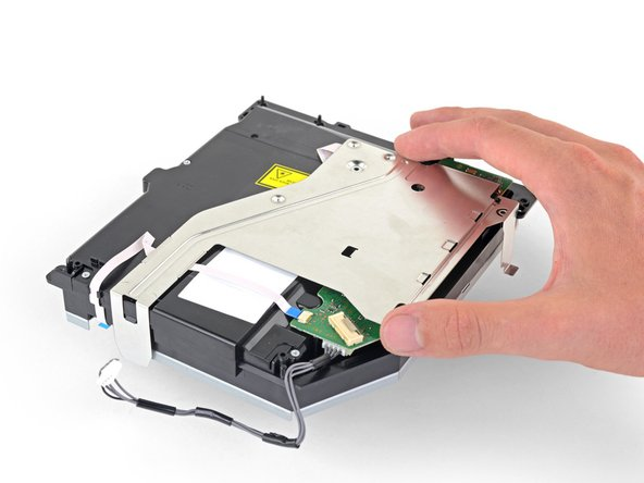 Lift the metal bracket straight up to separate it from the optical drive.