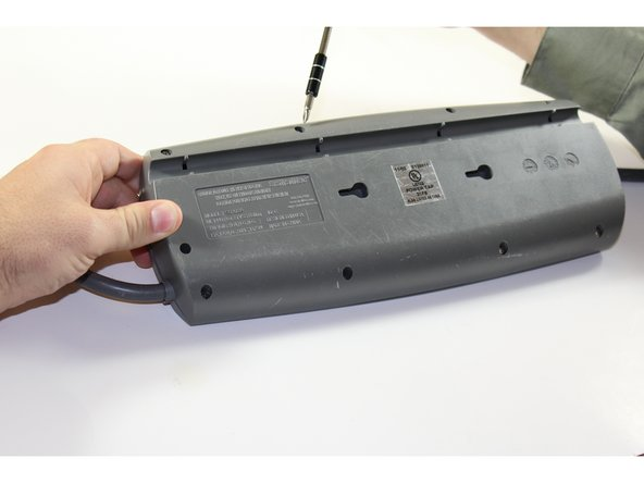Remove the nine screws from the bottom plate using an IfixIt bit driver and the bit labeled PH1.