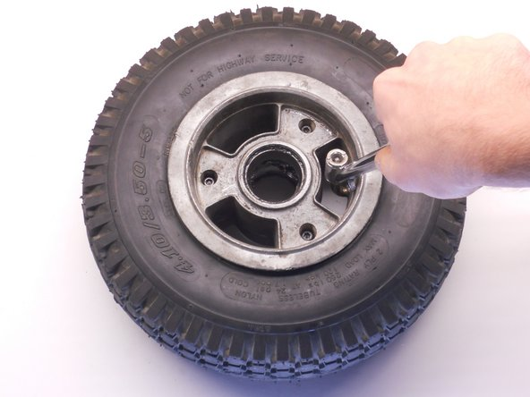 Use an air compressor with a tire inflator attachment (or any car tire inflator) to inflate the tire.