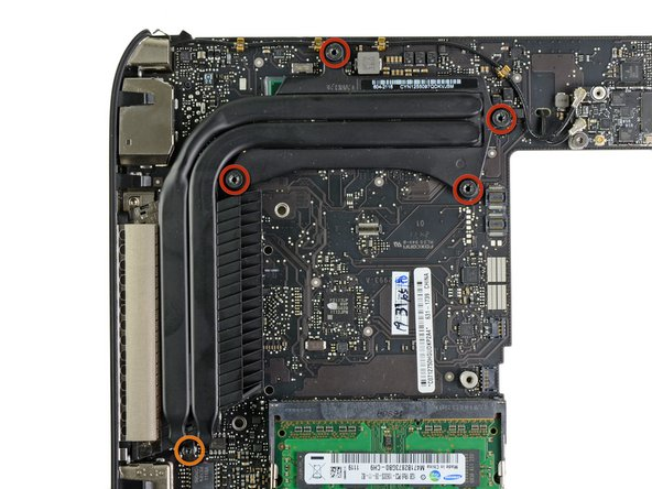 Remove the following screws securing the heat sink to the logic board: