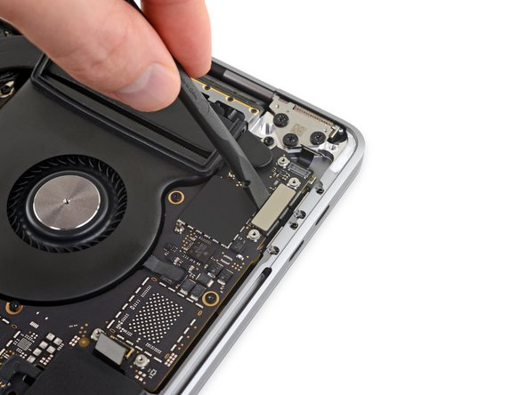 Repeat to disconnect the Thunderbolt flex cable connector on the opposite side.