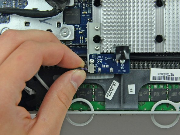 Disconnect the IR board cable by pulling its connector toward the left edge of your iMac.