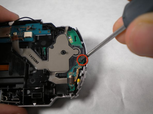 Remove the screw from the power switch board.